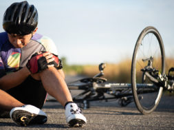 Bike injuries. Man cyclist fell fell off road bike while cycling