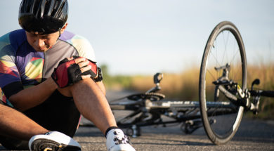 Bike injuries. Man cyclist fell fell off road bike while cycling