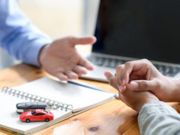 finance-staff-are-recommending-car-loans-for-custo-L7S38R6-min-1110×550