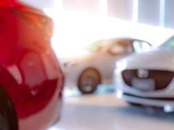 blurred-of-white-and-red-luxury-car-parked-in-mode-VATXL76-min-1110×550
