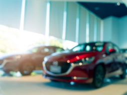 blurred-suv-car-parked-in-modern-showroom-car-deal-JDXAXU3-min-1110×550